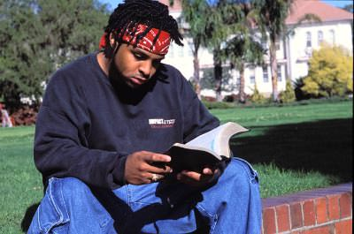 Student Reading Bible On Campus